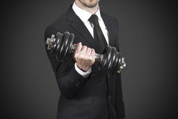 businessman in black suit weightlifting