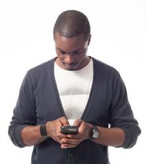 Casual dressed black man looking his mobile phone.