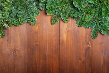 Fir branches on wooden boards