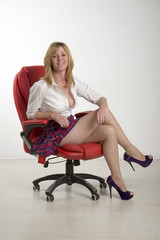 Woman sitting on a red leather chair