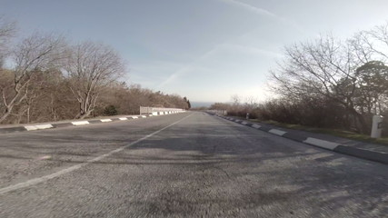 Car driving on empty road coast along Black Sea