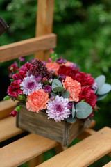 floral arrangement in the garden on a wooden staircase bright be