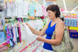 woman buying baby clothes