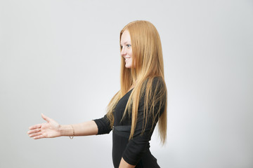 Business woman stretches out his hand for a handshake