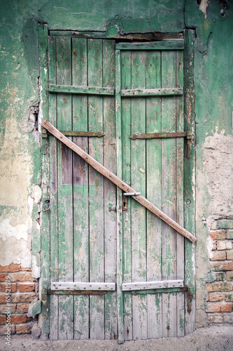 Boarded up windows and old door