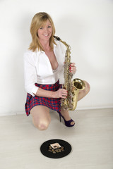 Woman busking with her saxophone