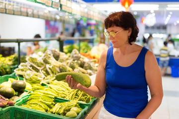 woman buys zucchini