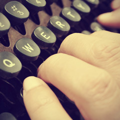 typing on an old typewriter, with a retro effect