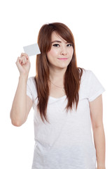 Asian girl show a white card and smile