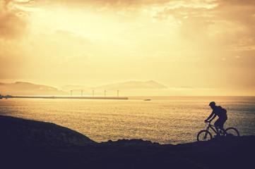 biker silhouette riding