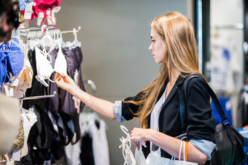 woman choosing clothes at the shop