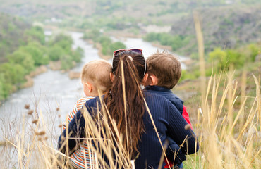 Mother with two boys enjoying a day in nature
