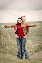 Attractive happy couple posing in the wilderness