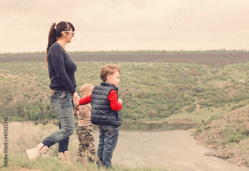 Little boy pointing to something in the country