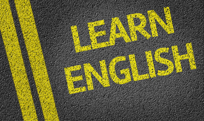 Learn English written on the road