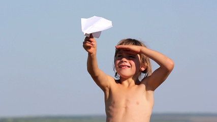 Boy launches a paper airplane.