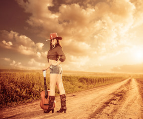 cowgirl with guitar