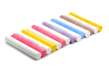 Colored chalks on white background
