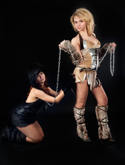 Two girls in barbarian and cat costumes