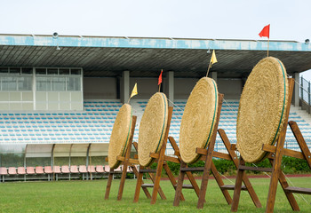 Archery straw empty targets in wooden stands