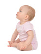 Infant child baby toddler sitting happy looking at the corner - 65528106