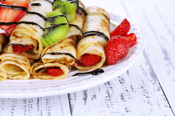 Delicious pancakes with strawberries and chocolate