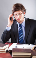 Businessman reading documents and talking