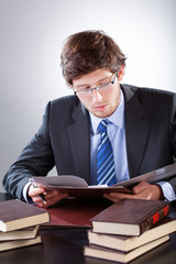 Young businessman reading books