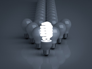 Leadership concept glowing Eco energy saving light bulb leads