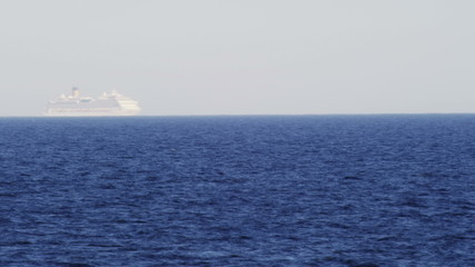Timelapse shot - cruise ship passing by on the horizon