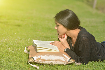 Women reading book  in autmn park