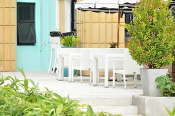 White table set in the garden