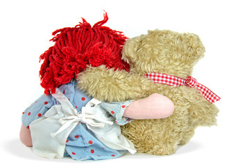 old rag doll with teddy bear on white background
