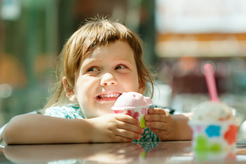 child eating ice cream in  cafe
