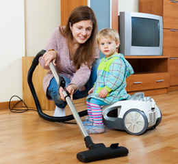 Housewife  cleaning living room with vacuum cleaner
