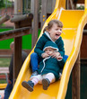 two happy children on slide