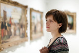 woman looking pictures in  museum