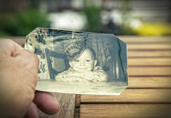 man holding childhood photo