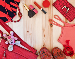 fashionable women's clothing and accessories in red tones