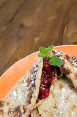 Baked pancakes with jam
