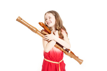 young girl with recorders