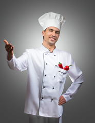 Humorous portrait of a proud chef, gray background