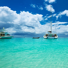 Beautiful beach with boats at Seychelles