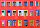Red facade with colourful windows