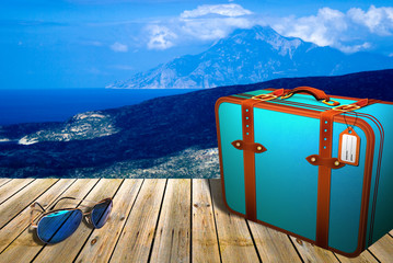 Wood pier with sunglasses and travel suitcase