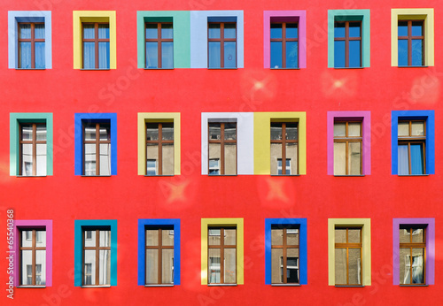 canvas print picture Red facade with colourful windows