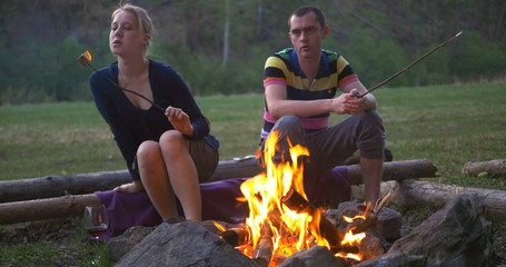 roasting marshmallows at camping fireplace. Ultra HD 4K video