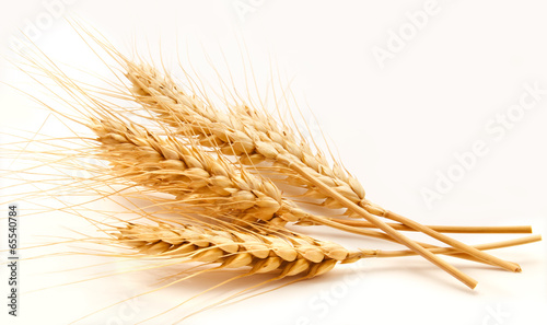 Fotobehang Granen Wheat ears isolated on a white