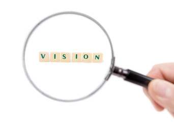 Magnifier enlarges the word vision. On a white background.