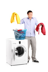 Man wondering how to do the laundry